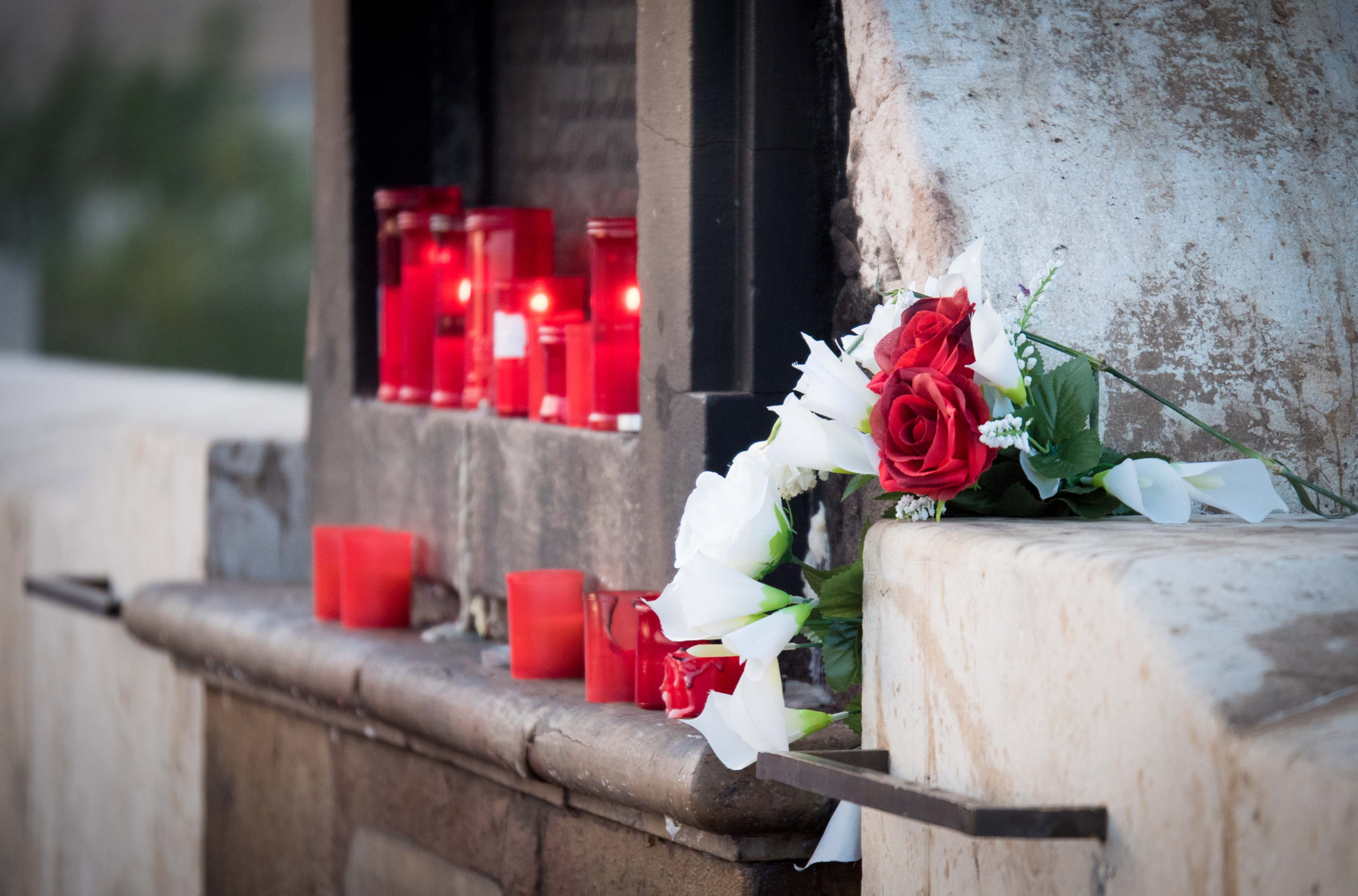 Flowers and Candles to the VirginMary